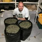Detective Regan Boucher, of the Southern District Organised Crime Squad, with some of the...
