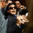 Diego Maradona argues with television reporters as he leaves a courthouse in Buenos Aires....