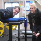Discus thrower Marshall Hall works on his strength and conditioning while watched by triathlete...