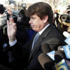 Disgraced former Illinois governor Rod Blagojevich leaves his Chicago home for the second day of...