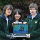 Displaying a computer game designed for the New Zealand Dolphin and Whale Trust are Bayfield High...