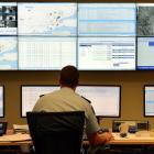 District Command Centre deployment co-ordinator Senior Sergeant Craig Brown keeps an eye on what...
