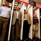 Dixville Notch residents wait for the stoke of midnight to be the first voters for the nation's...