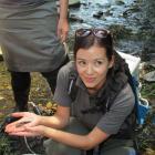 Doc coastal Otago freshwater ranger Lan Pham shows off some of the aquatic life in Oamaru Creek.