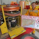 Doc Wakatipu rural fire officer Jamie Cowan stands beside a medium volume helibox pump, used to...