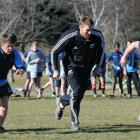 Doing a running drill with Brad Thorn during an All Black visit to Cromwell yesterday are...