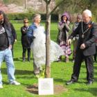 Domestic violence prevention spokesman Vic Tamati and Waitaki Mayor Alex Familton unveil a plaque...