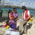 Douglas Clark distributes aid in Vanuatu following Cyclone Pam. Photos supplied.