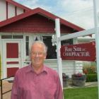 Dr Ron Sim outside the chiropractic practice which has been in family hands for 80 years. Photo...