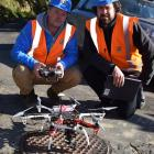Drone pilot Aaron McGrouther (left) and Fulton Hogan laboratory manager Dr Sean Connaughton with...