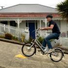 Dunedin AvantiPlus bike mechanic Mac Robertson tests the eZee electric bike up Baldwin St in...