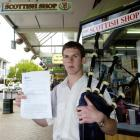Dunedin bagpiper Simon McLean is angry he was served with a noise infringement notice by a...