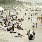 Dunedin bathers flocked to St Clair beach yesterday to make the most of a brief window of...