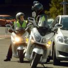 Dunedin City Council chief executive Sue Bidrose (left)  speaks with parking officer ''Marty'' on...