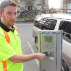 Dunedin City Council parking meter technician Reece Smith  checks the credit card-reader in a...