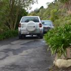 Dunedin city councillor John Bezett's Toyota RAV4 blocks the vehicles of Steve and Lorraine...