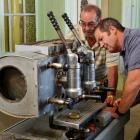 Dunedin espresso experts Brian Johnston (left) and Kevin Smart inspect the vintage coffee machine...
