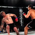 Dunedin fighter Apii Taia (right) puts down Christchurch's Benji Kney during the fight night at...