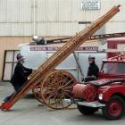 Dunedin Fire Brigade Restoration Society president Paul Clements (left) takes a close look at a...
