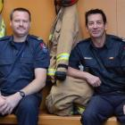 Dunedin firefighters Nigel Manson (left) and Pete Douglas recently received their gold stars....