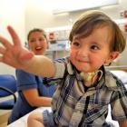 Dunedin Hospital children's ward nurse Colette Helleur with 18-month-old Brendan Forbes, who is a...