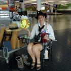 Dunedin International Airport customer services officer Clare  Doherty sits yesterday with some...