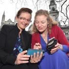 Dunedin lawyers Jackie St John (left) and Rachel Brooking test the Octagon's new gigabit Wi-Fi...