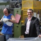 Dunedin manufacturer Norman Wood smiles as  employee Barry Gibbs creates plastic containers at...