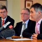 Dunedin Mayor Dave Cull discusses the cost of the Carisbrook deal yesterday, watched by (from...