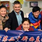 Dunedin Mayor Dave Cull gives pupils from the Qi Bao No.2 Middle School in Shanghai a sample of...