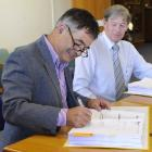 Dunedin Mayor Dave Cull signs the $26.7 million contract for Dunedin's new kerbside collection...
