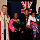 Dunedin Mayor Dave Cull with  new New Zealand citizens (from left) Ruvarashe Manonose (11), her...