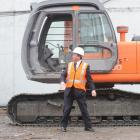 Dunedin Mayor Peter Chin after an eventful turn at the controls of an excavator yesterday. Photo...
