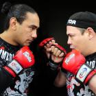 Dunedin mixed martial arts sparring partners Apii Taia (left) and Matt Toa eyeball each other....