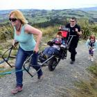 Dunedin mother Claire Casey navigates son Finn  (9) up the Pineapple Track in the new TrailRider...