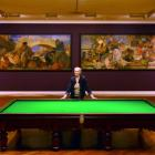 Dunedin Public Art Gallery collections  manager Robyn Notman stands beside a billiards table in...