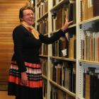Dunedin Public Library heritage collection librarian Lorraine Johnston is pleased a condensation...