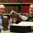 Dunedin Public Library rare books librarian Anthony Tedeschi (left) and University of Otago...