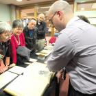 Dunedin Public Library rare books librarian Anthony Tedeschi (right) shows one of the thousands...