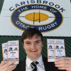Dunedin resident James Columb gets his tickets for the test between the All Blacks and Fiji at...