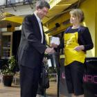 Dunedin resident Murray Schofield makes a donation to Maria Currie in the Octagon, Dunedin...