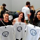 Dunedin residents (from left) Amanda Gould, Shanaya Allan and Melissa Cottle show their screen...