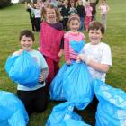 Dunedin's Rotary Park School pupils (front, from left) Nathan Farr (9), Ellie Jones (6), Ella...