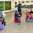 Dunedin School of Art senior sculpture lecturer Scott Eady walks between ''Site 2013''...