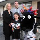 Dunedin Tech football player Charlotte Wheeler with her parents, Julie and Gavin Wheeler, and the...