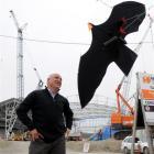 "Dunedin Venues Management Ltd chief executive David Davies inspects an Adams Flags ""Sky Crow"" -..."