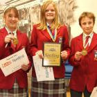 Dunstan High School pupils (from left) Charlotte Stringer, Stine-Lise Budge and NIck Pascoe, all...
