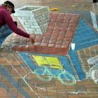 Dutch street artist Leon Keer works on his three-dimensional artwork in the Octagon, Dunedin,...