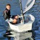 Dylan Edwards (13), of King's High School, pilots his Optimist yacht at Macandrew Bay on Monday....