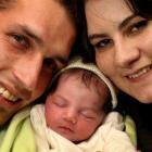 Earthquake 'miracle' Dianthe Barnard, pictured with parents Evert Barnard (left) and Maruschke...